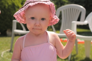 Baby in a pink bonnet