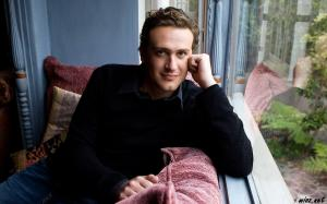 Jason Segel by a window